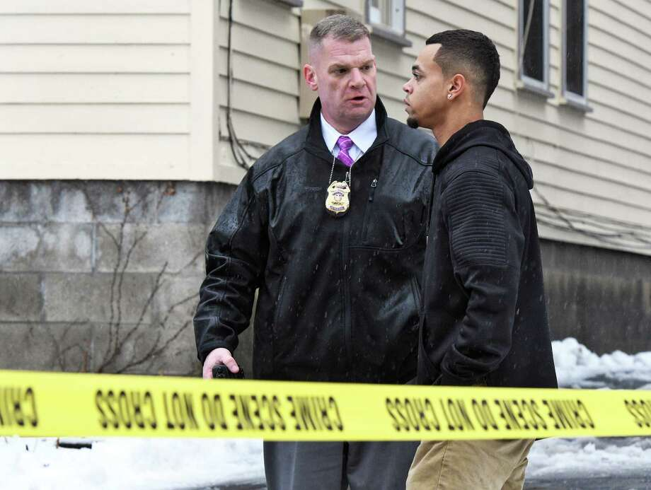 Detective Sgt. Dan Kane, left, speaks with Kory McNair, step-son of shooting victim Johnny Jones, outside Jones' 856 Union Street residence Tuesday afternoon, Jan. 24, 2017, in Schenectady, N.Y.  (John Carl D'Annibale / Times Union) Photo: John Carl D'Annibale