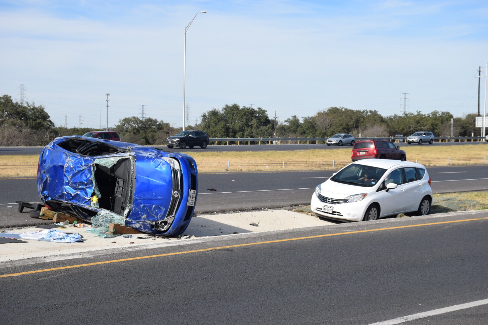 Loop 1604 closed after violent rollover crash sends woman ...