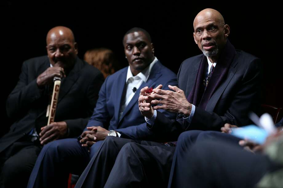 Jim Brown (left), ex-NFL player Takeo Spikes and Kareem Abdul-Jabbar were among those taking part in the program. Photo: Santiago Mejia, The Chronicle