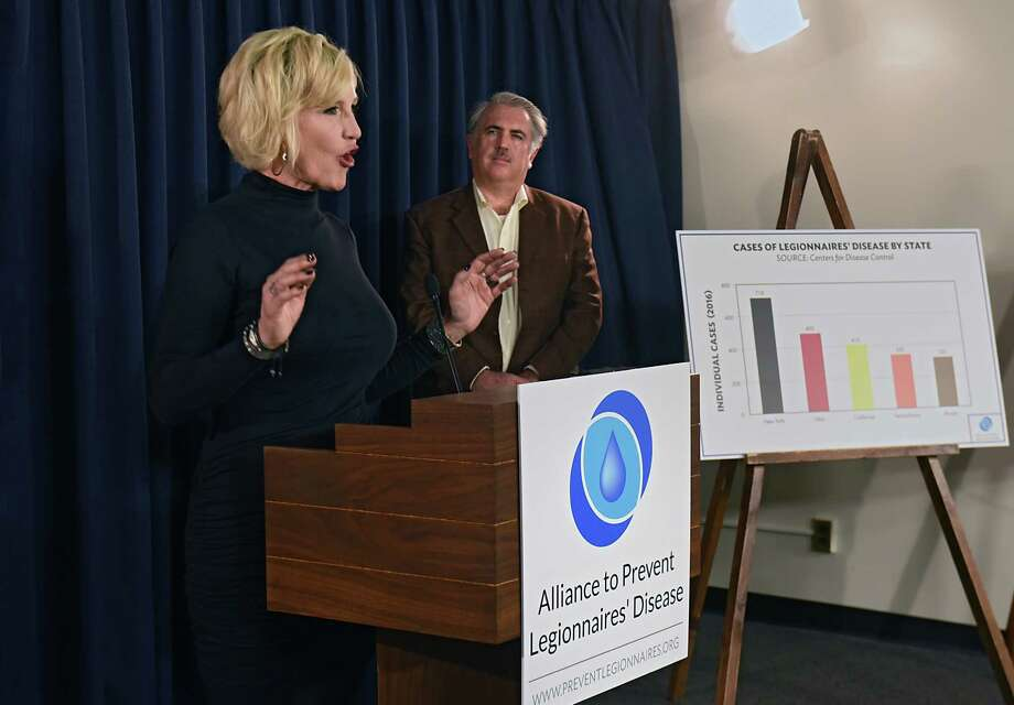 Public health and environmental advocate Erin Brockovich, left, and Robert Bowcock of Integrated Resouce Management join the Alliance to Prevent Legionnaires' Disease and the Allergy and Asthma Network as they hold a press conference at the Legislative Office Building on Tuesday, Jan. 24, 2017 in Albany, N.Y. The advocates are calingl on lawmakers and health officials to work towards real, effective solutions to New York's escalating Legionella and Legionnaires' disease crises. (Lori Van Buren / Times Union) Photo: Lori Van Buren / 20039519A
