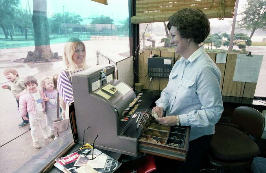 Peggy Davis sell tickets to board the Hermann Park train, Jan. 8, 1987. Photo: Buster Dean, Houston Chronicle