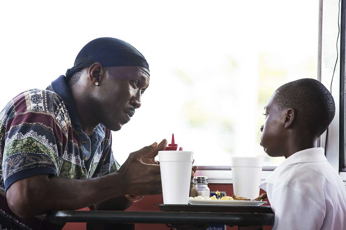 """This image released by A24 Films shows Mahershala Ali, left, and Alex Hibbert in a scene from, """"Moonlight."""" Ali was nominated for an Oscar for best supporting actor on Tuesday, Jan. 24, 2017, for his work in the film. The 89th Academy Awards will take place on Feb. 26. (David Bornfriend/A24 via AP)"""