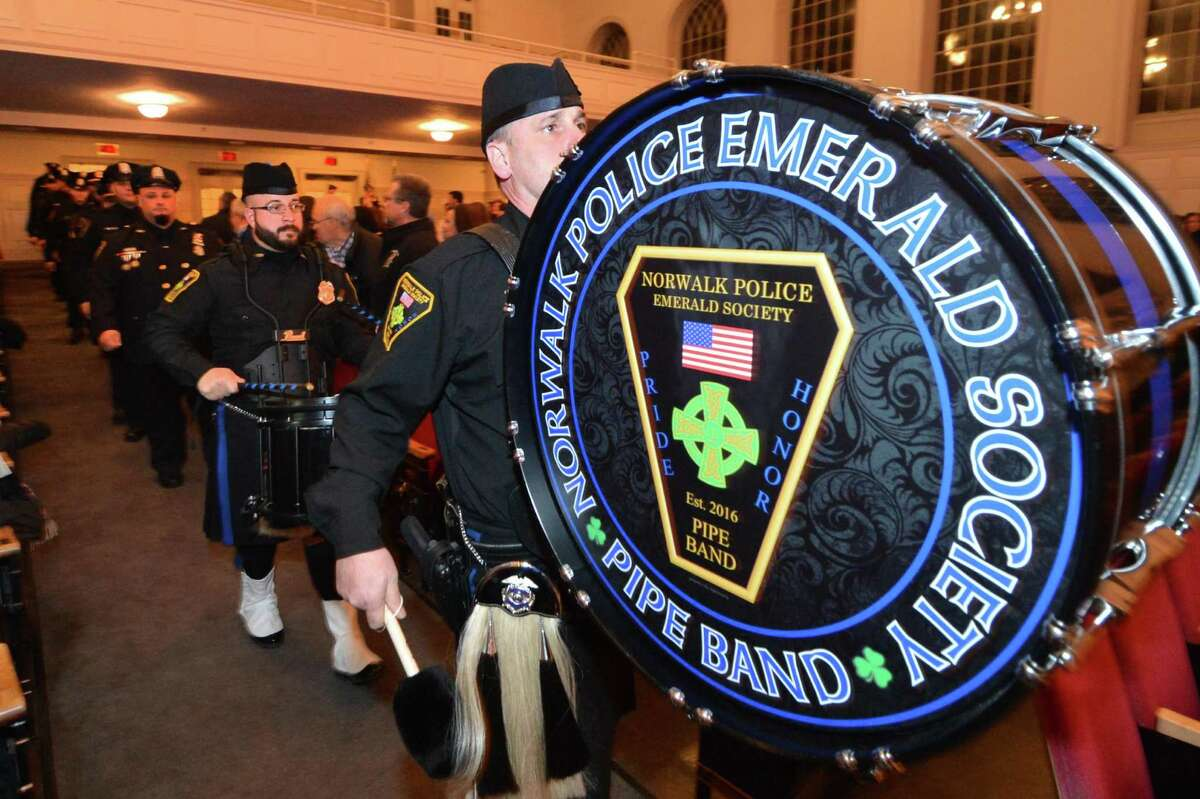 The Norwalk Police Emerald Society Pipe Band plays during the Norwalk police awards program at Norwalk City Hall.