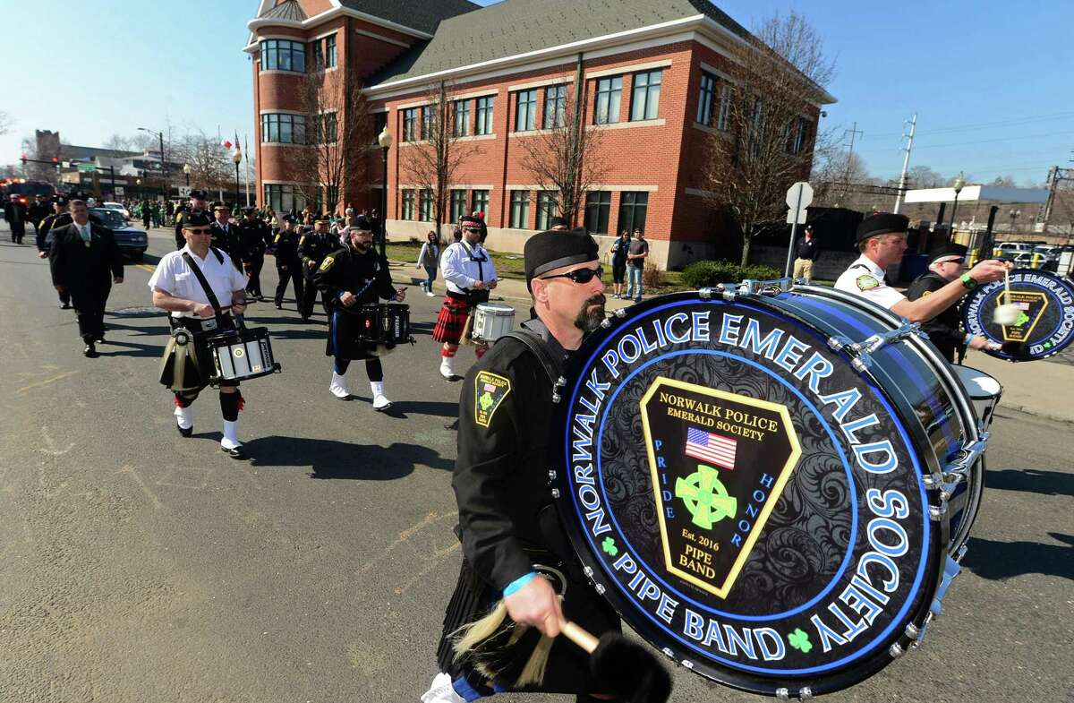 The Norwalk Police Emerald Society Pipe Band participates in the first Norwalk St. Patrick's Day parade Thursday, March 17, 2016, which made it's way down South and North Main Streets ending at O'Neill's Pub.