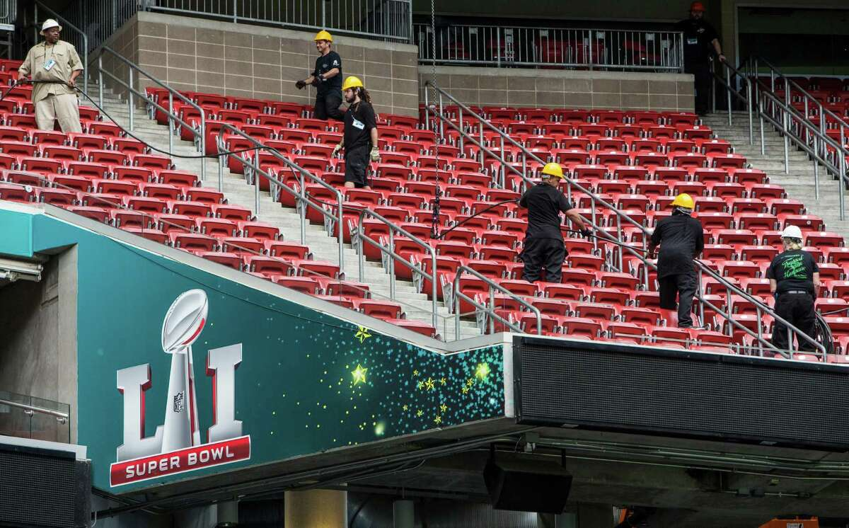 Workers prepare NRG Stadium for Super Bowl LI on Tuesday, Jan. 24, 2017, in Houston. The New England Patriots play the Atlanta Falcons on February 5, for the NFL title.