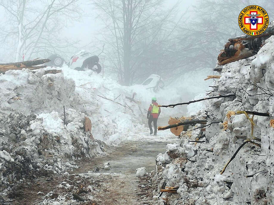 This picture made available on Tuesday, Jan. 24, 2017 by the Italian Mountain Rescue Service 'Corpo Nazionale Soccorso Alpino e Speleologico' (CNSAS) shows a cleared pathway by the site of the avalanche-buried Hotel Rigopiano, near Farindola. Italy. The death toll from an avalanche in central Italy climbed to 14 on Tuesday as hopes began to fade that any of the 15 people still missing might be found alive under a mountain resort buried by tons of snow and rubble. (Corpo Nazionale Soccorso Alpino e Speleologico/ANSA via AP) Photo: Corpo Nazionale Soccorso Alpino E Speleologico, HOGP / ANSA