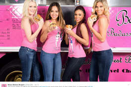 """A new hamburger food truck is headed to Houston just in time for the big game. Baby's Badass Burgers boasts a """"futuristic truck"""" with """"burger babes"""" behind the counter.   Source:  Twitter"""