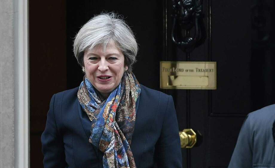 Britain's Prime Minister, Theresa May, leaves Downing Street in London Tuesday Jan. 24, 2017. Britain's government must get parliamentary approval before starting the process of leaving the European Union, the Supreme Court ruled Tuesday, potentially delaying Prime Minister Theresa May's plans to trigger exit negotiations by the end of March.  (Victoria Jones/PA via AP) Photo: Victoria Jones, SUB / PA