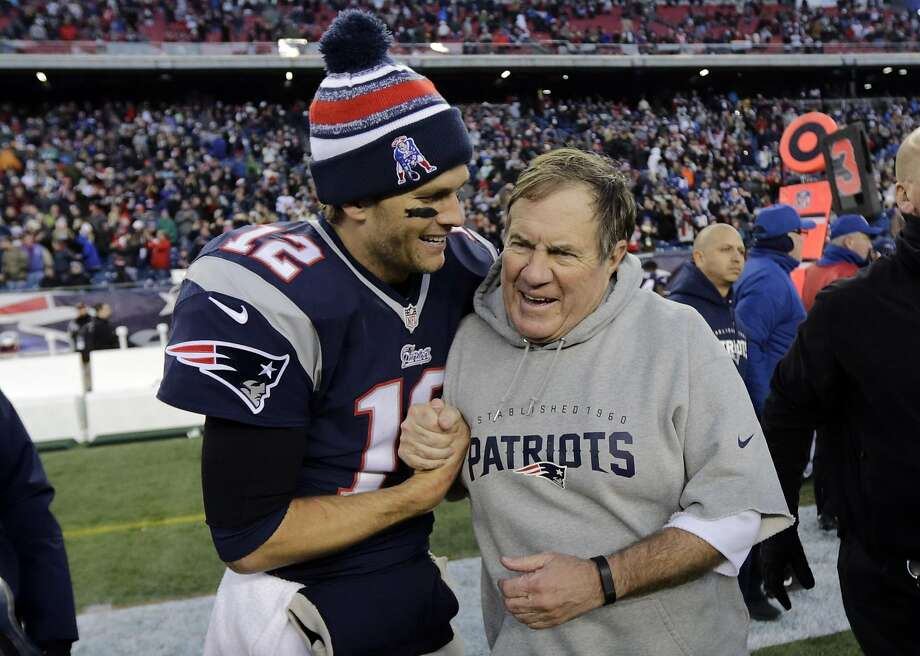New England Patriots quarterback Tom Brady, left, celebrates with head coach Bill Belichick after defeating the Miami Dolphins 41-13 in an NFL football game Sunday, Dec. 14, 2014, in Foxborough, Mass. (AP Photo/Charles Krupa) Photo: Charles Krupa, AP