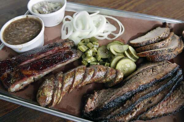Ribs, sausage, brisket and turkey, served with pickles, onions, cactus, beans and potato salad.
