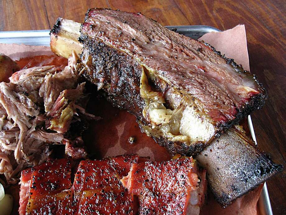 Beef ribs are a Saturday-only event at 2M Smokehouse. Photo: Mike Sutter /San Antonio Express-News