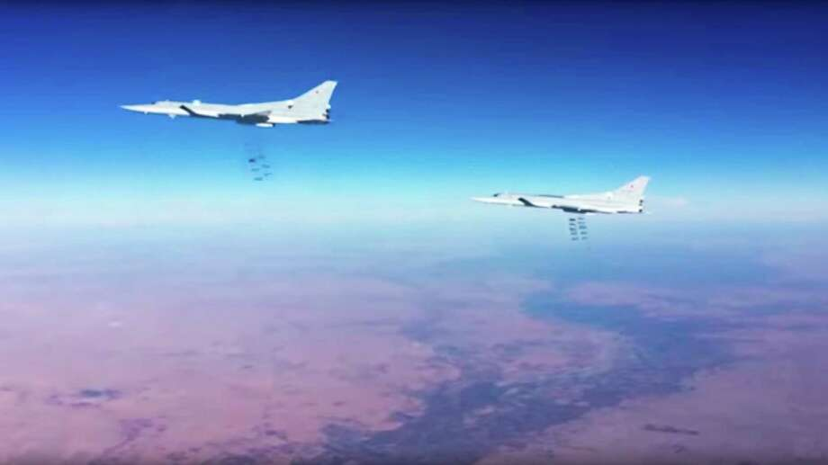 This photo provided by the Russian Defense Ministry Press Service shows Russian air force Tu-22M3 bombers strike the Islamic State group in Syria on Tuesday. Photo: HOGP / Russian Defense Ministry Press Service