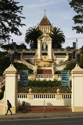 A woman walks in front of stairs on Turk Street that lead to the main building on USF's Lone Mountain Campus on November 6, 2013 in San Francisco, Calif. The steps were modeled after Rome's Spanish Steps, according to a University spokesperson.