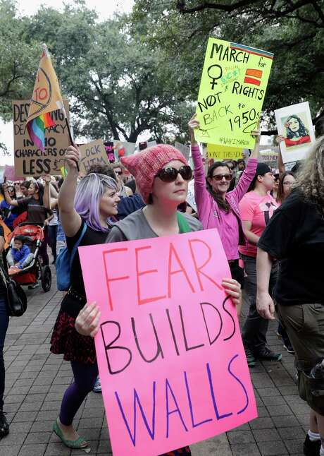 Protesters hold signs as they enter Hermann Square at the Houston Women's March in Houston on Saturday, Jan. 21, 2017. (For the Chronicle) Photo: Tim Warner, Freelance / Houston Chronicle