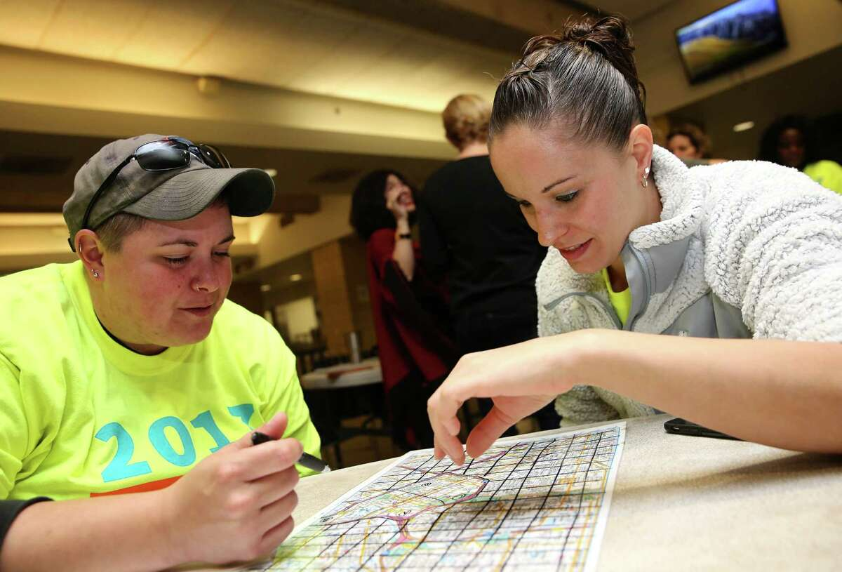 Volunteers Jess DiManno, left, and Jessica Preheim study the map of the areas they are covering for the annual homeless count at The Beacon Tuesday, Jan. 24, 2017, in Houston. ( Yi-Chin Lee / Houston Chronicle )