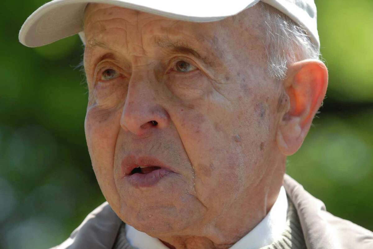Jack Galek, a Holocaust survivor who was at Auschwitz, talks about the the Holocaust Memorial at the Beth Emeth cemetery on Sunday, May 13, 2007, in Loudonville, N.Y. Members of the synagogue gathered to rededicated the Holocaust Memorial which under went some landscaping. (Paul Buckowski/Times Union archive)