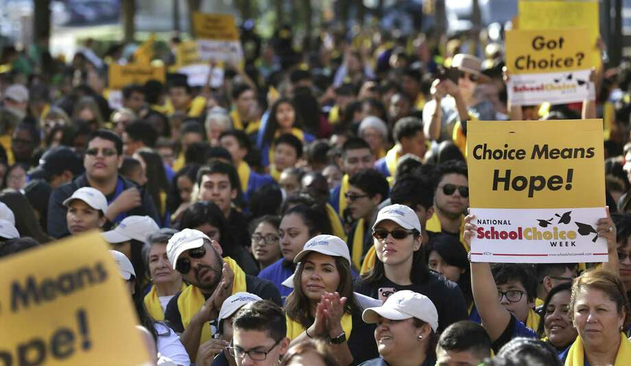 Parents, students and school administrators pack the walkway of the Texas State Capitol at the Texas Coalition School Choice Rally, commemorating National School Choice Week on Tuesday. Photo: Bob Owen /San Antonio Express-News / ©2017 San Antonio Express-News