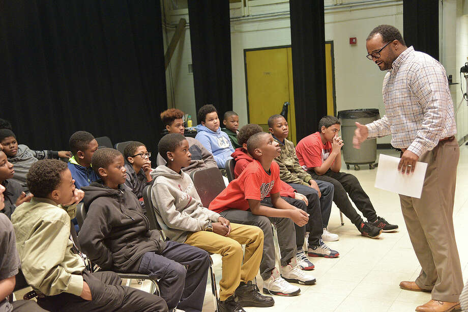 Lawrence Peoples, a teacher at Welborn Middle School, encourages students to have a dialogue about their career vision during the school's Shop Talk program Monday, Jan. 23, 2017, in High Point, N.C. (Laura Greene/The High Point Enterprise via AP) Photo: Laura Greene, MBI / The High Point Enterprise