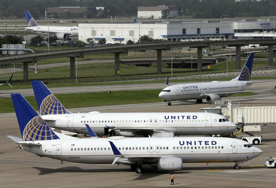 FILE - In this July 8, 2015, file photo, a United Airlines plane, front, is pushed back from a gate at George Bush Intercontinental Airport in Houston. United Continental Holdings, Inc. reports financial results on Tuesday, Jan. 17, 2017. (AP Photo/David J. Phillip, File) Photo: David J. Phillip, Associated Press