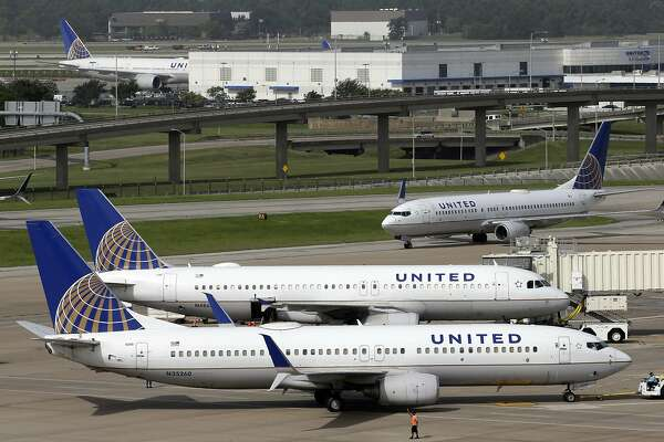 FILE - In this July 8, 2015, file photo, a United Airlines plane, front, is pushed back from a gate at George Bush Intercontinental Airport in Houston. United Continental Holdings, Inc. reports financial results on Tuesday, Jan. 17, 2017. (AP Photo/David J. Phillip, File)
