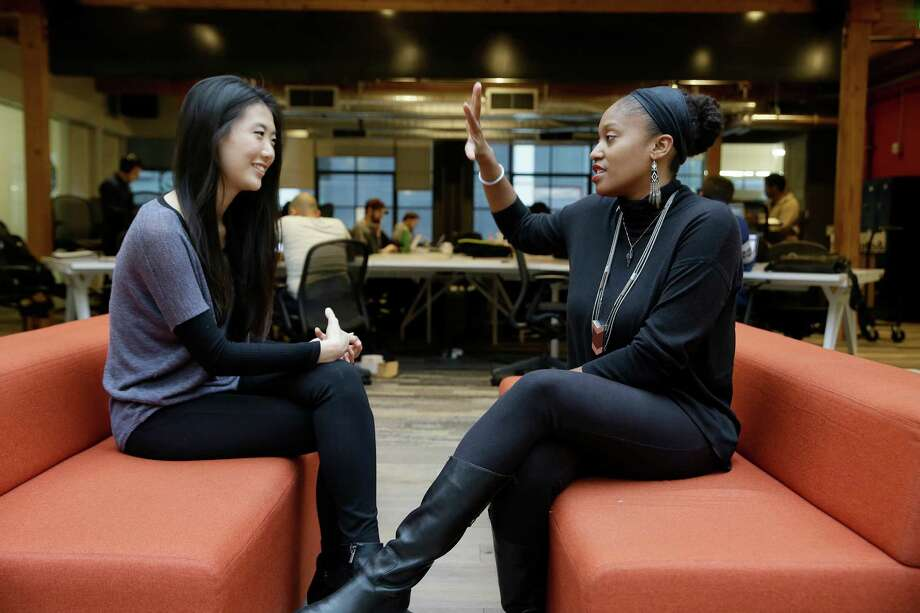 In this Tuesday, Jan. 3, 2017, photo, Aniyia Williams, founder and CEO of Tinsel, right, talks about program placement with Kara Lee, at the offices of Galvanize in San Francisco. Williams says she has made sure to hire women as well as underrepresented minorities. Tinsel makes tech jewelry targeted at women. (AP Photo/Eric Risberg) Photo: Eric Risberg, STF / Copyright 2017 The Associated Press. All rights reserved.