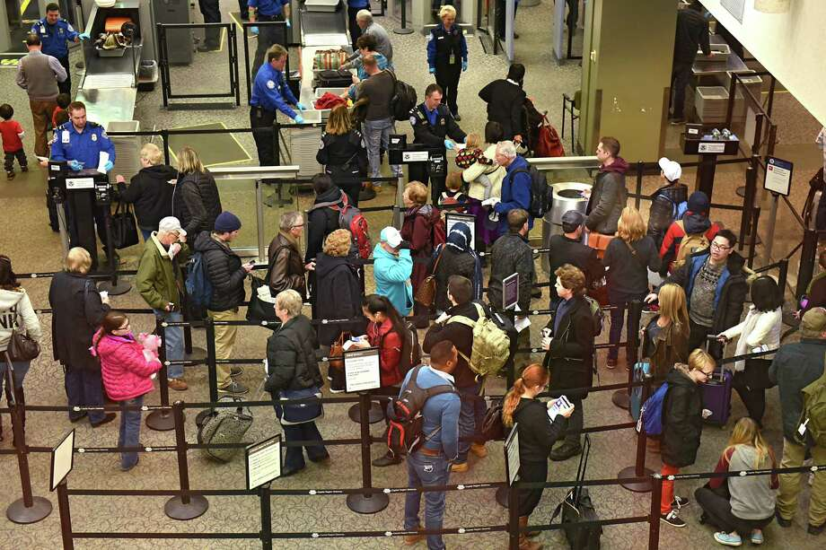 People line up at the TSA check point at the Albany International Airport on Tuesday, Dec. 20, 2016 in Colonie, N.Y. (Lori Van Buren / Times Union) Photo: Lori Van Buren / 20039201A