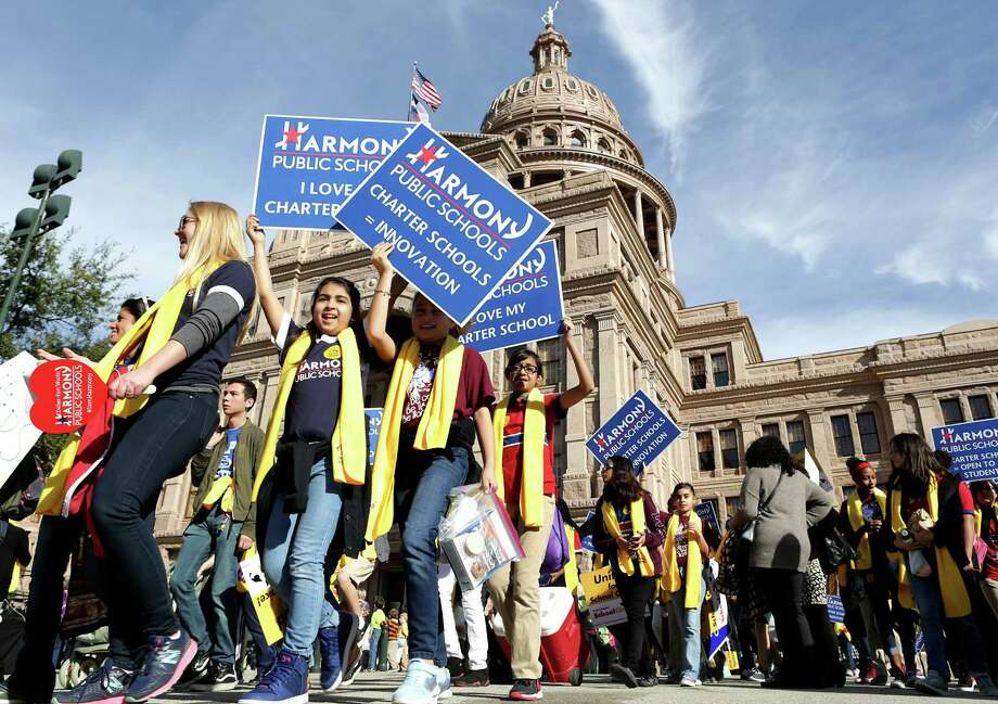 Students from Dallas/Fort Worth Harmony Schools arrive with others Tuesday at the state Capitol. Photo: Bob Owen, Staff / ©2017 San Antonio Express-News