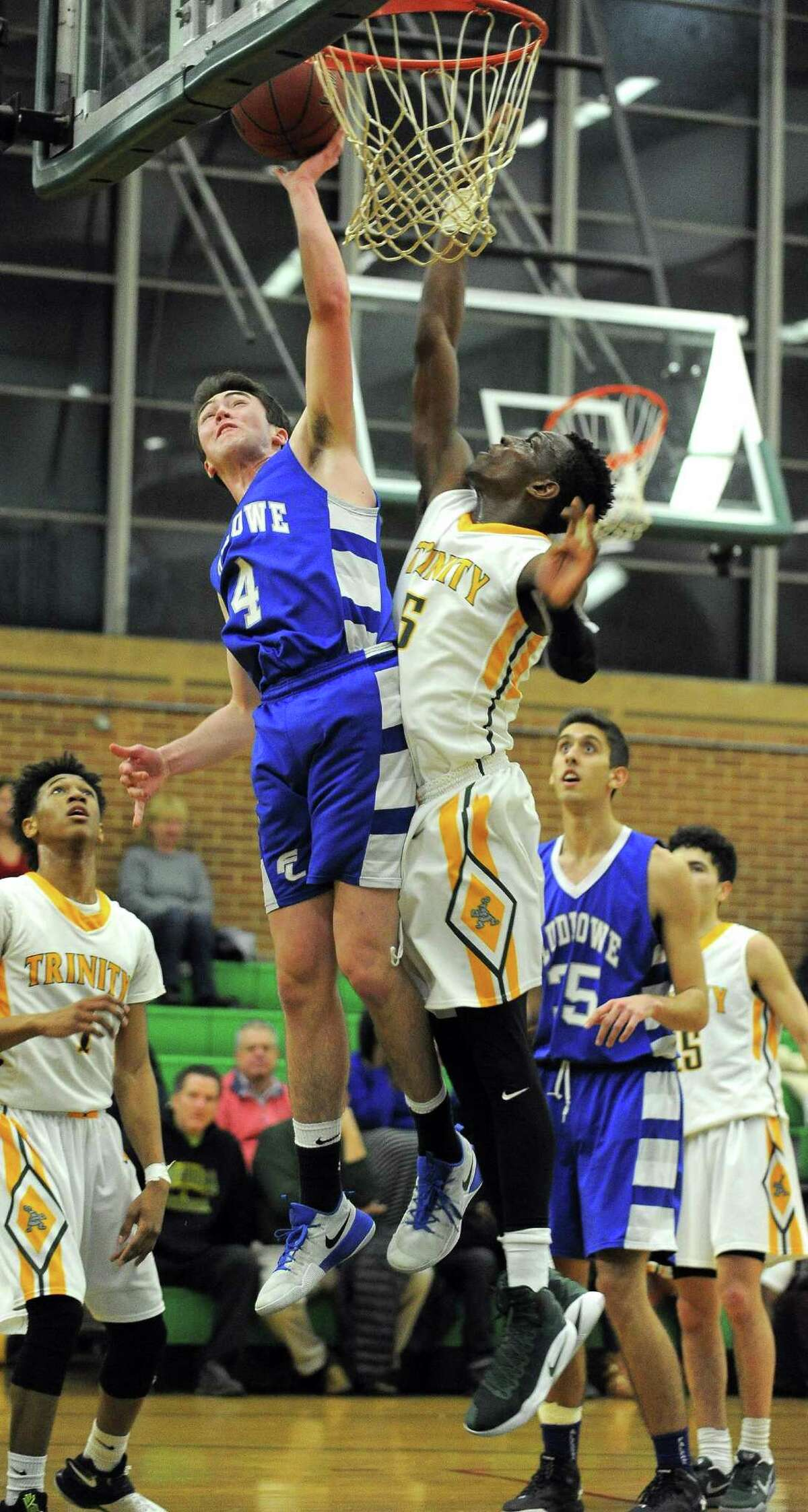 Ludlowe Sean Chase puts up a shot against Trinity Contavio Dutreil in an FCIAC boys basketball game at Trinity Catholic High School's Walsh Court in Stamford, Conn. on Jan. 24, 2017.