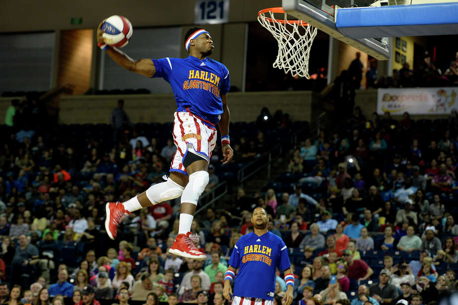 "Harlem Globetrotter ""Clutch"" Ball dunks while warming up before their exhibition at Ford Arena on Tuesday night.  Photo taken Tuesday 1/24/17 Ryan Pelham/The Enterprise Photo: Ryan Pelham / ©2017 The Beaumont Enterprise/Ryan Pelham"