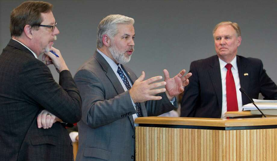 Montgomery District Attorney Brett Ligon, center, addresses members of the Montgomery County Commissioners Court concerning purposed ethics policy as B.D. Griffin, Montgomery County assistant county attorney, left, and County Attorney J D Lambright look on during a meeting Tuesday, Jan. 24, 2017, in Conroe. The policy stems from new grant guideline requirements by the Texas Department of Transportation, which includes training, record keeping of training and any additional hours. Photo: Jason Fochtman, Staff Photographer / Houston Chronicle