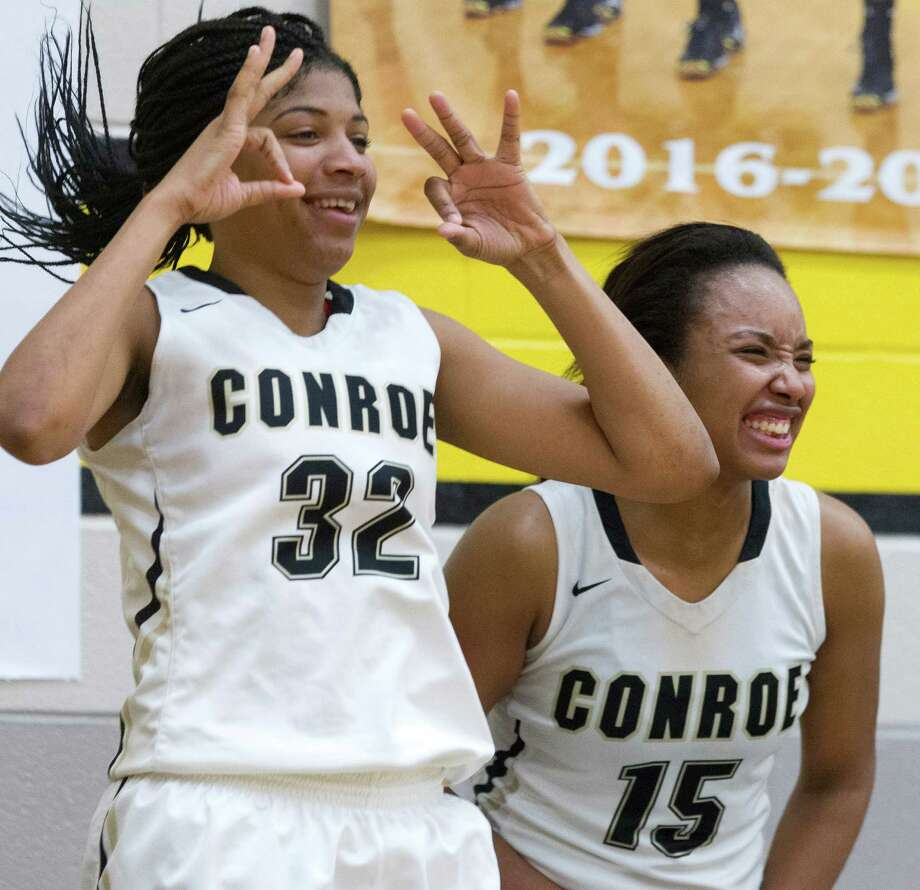 Conroe centers Maya Grant (32) and Victoria Ratcliff (15) celebrate a three-pointer during the third quarter of a District 16-6A high school girls basketball game at Conroe High School, Jan. 24, 2017, in Conroe. Conroe defeated Montgomery 80-28. Photo: Jason Fochtman, Staff Photographer / Houston Chronicle