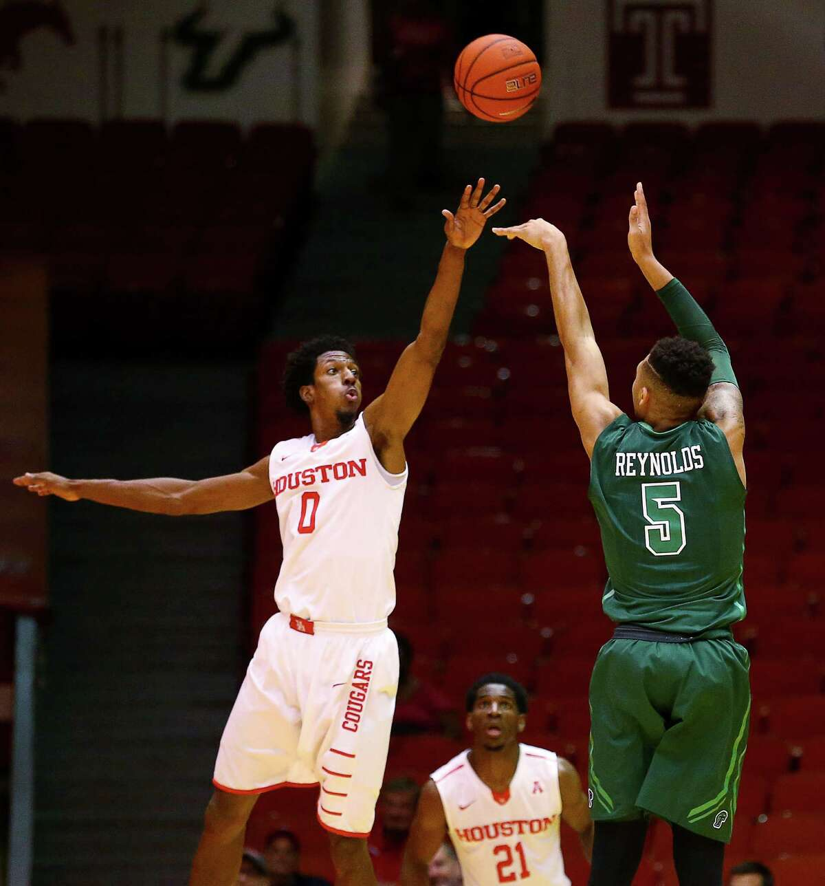 Houston Cougars forward Danrad Knowles (0) tries to block a shot by Tulane Green Wave guard Cameron Reynolds (5) during the first half of an NCAA basketball game at Hofheinz Pavillion, Tuesday, Jan. 24, 2017, in Houston.