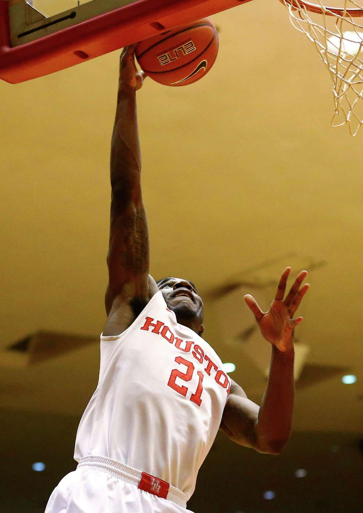 Houston Cougars guard Damyean Dotson (21) drives to the basket during the first half of an NCAA basketball game against the Tulane Green Wave at Hofheinz Pavillion, Tuesday, Jan. 24, 2017, in Houston.