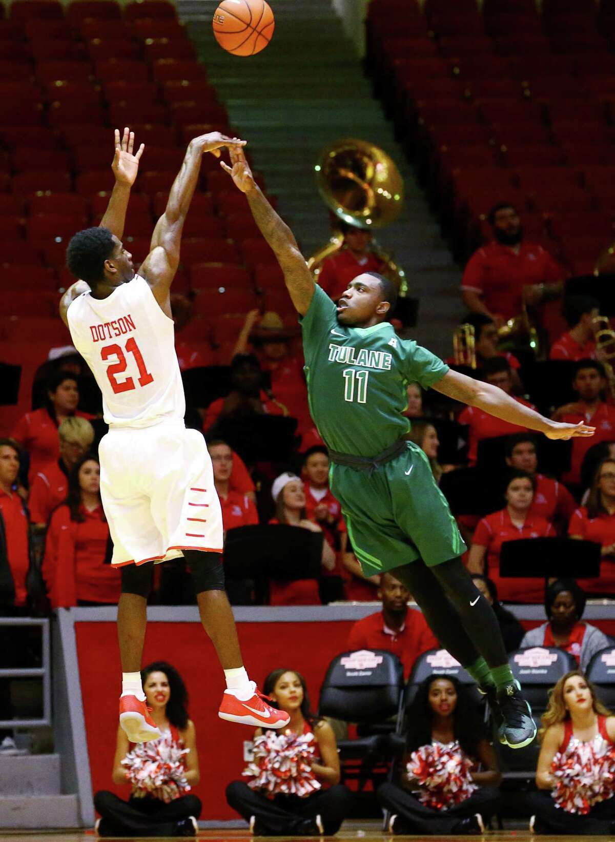 Houston Cougars guard Damyean Dotson (21) shoots over Tulane Green Wave guard Kain Harris (11) during the first half of an NCAA basketball game at Hofheinz Pavillion, Tuesday, Jan. 24, 2017, in Houston.