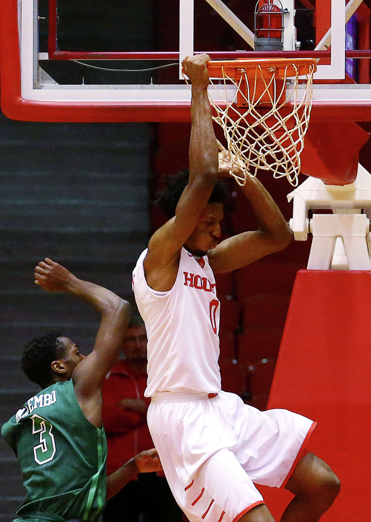 Houston Cougars forward Danrad Knowles (0) dunks the ball while Tulane Green Wave guard Ray Ona Embo (3) defends during the first half of an NCAA basketball game at Hofheinz Pavillion, Tuesday, Jan. 24, 2017, in Houston.
