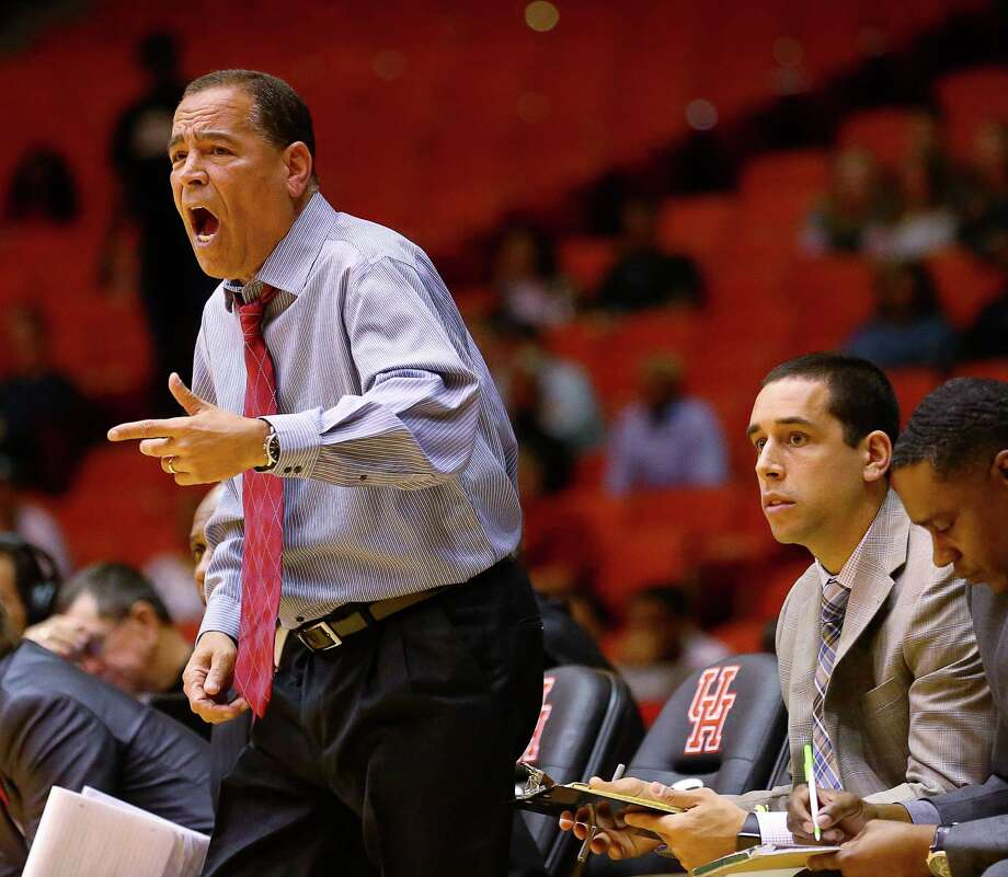 Houston Cougars head coach Kelvin Sampson, left, yells as his son, assistant coach Kellen Sampson, right, watches gameplay during the first half of an NCAA basketball game against the Tulane Green Wave at Hofheinz Pavillion, Tuesday, Jan. 24, 2017, in Houston. Photo: Jon Shapley, Houston Chronicle / © 2017  Houston Chronicle