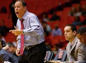 Houston Cougars head coach Kelvin Sampson, left, yells as his son, assistant coach Kellen Sampson, right, watches gameplay during the first half of an NCAA basketball game against the Tulane Green Wave at Hofheinz Pavillion, Tuesday, Jan. 24, 2017, in Houston.
