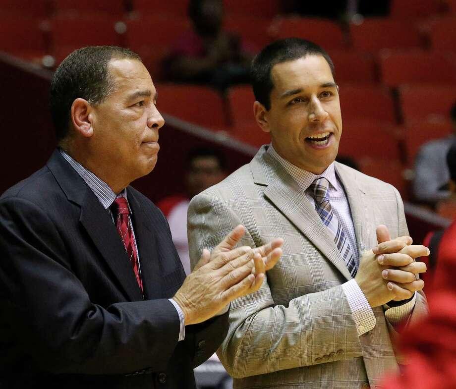 Head coach Kelvin Sampson, left, and son Kellen saw UH beat Tulane 65-51 at Hofheinz Pavilion on Tuesday night. Photo: Jon Shapley, Staff / © 2017  Houston Chronicle