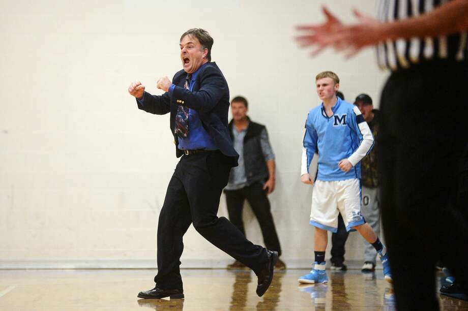 Meridian head coach Mitch Bohn yells to his team on Tuesday at Meridian High School. The Mustangs defeated the Chargers 48-41. Photo: Erin Kirkland/Midland Daily News