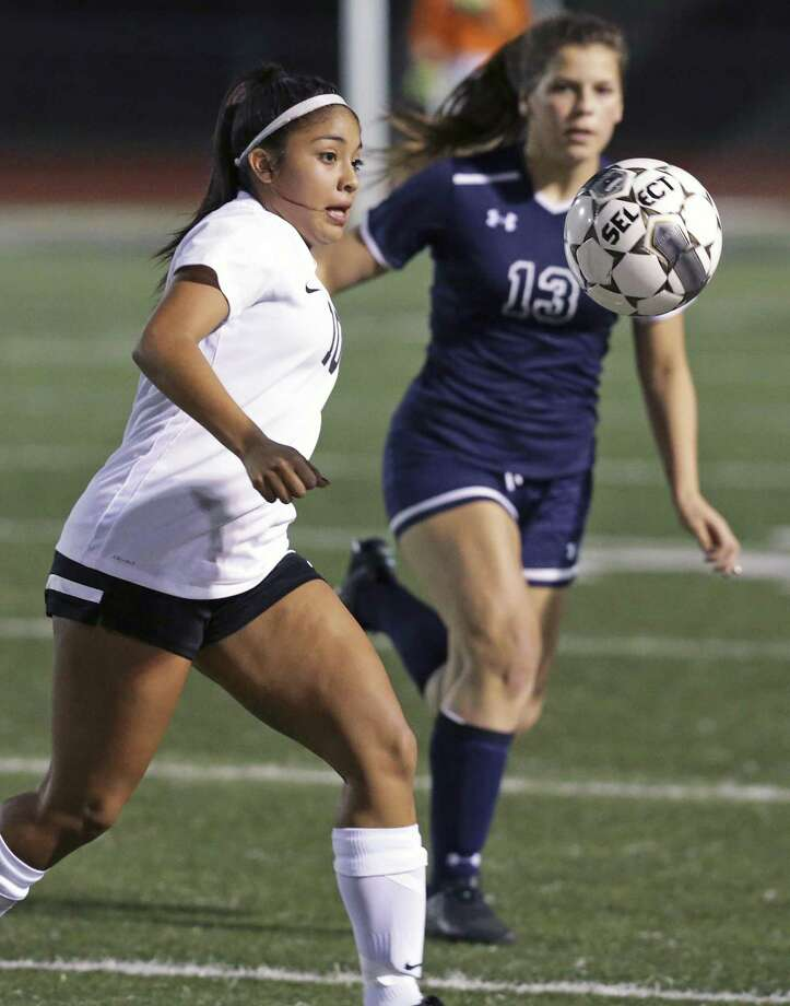The Knight's Mayela Villasenor controls in midfield against Damita Mendoza as Steele hosts Smithson Valley in girls soccer at Steele High School stadium on January, 24, 2017. Photo: Tom Reel, Staff / San Antonio Express-News / 2017 SAN ANTONIO EXPRESS-NEWS