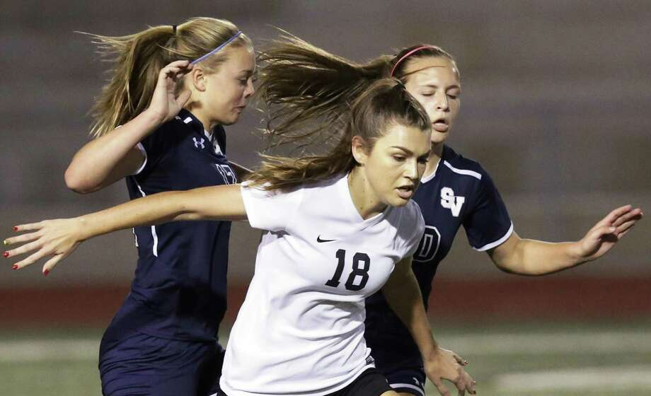 Emily Bailey blows through Ranger defenders Haley Smith (left) and Kaitlyn Smith as Steele hosts Smithson Valley in girls soccer at Steele High School stadium on January, 24, 2017. Photo: Tom Reel, Staff / San Antonio Express-News / 2017 SAN ANTONIO EXPRESS-NEWS