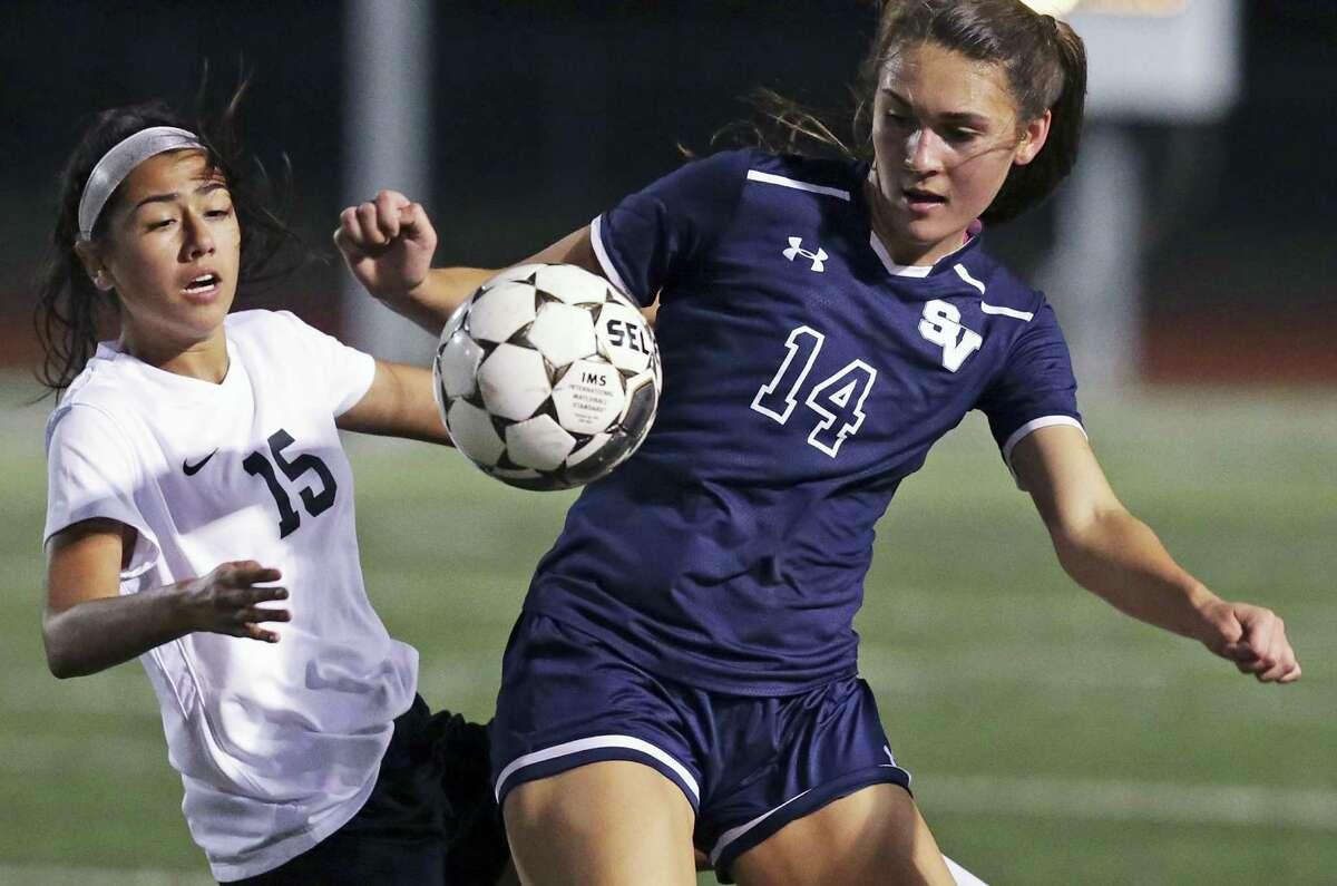 Smithson Valley's Erica Martinez (right) grabs a high ball against Steele's Gisselle Kozarski in girls soccer action on Jan., 24, 2017.
