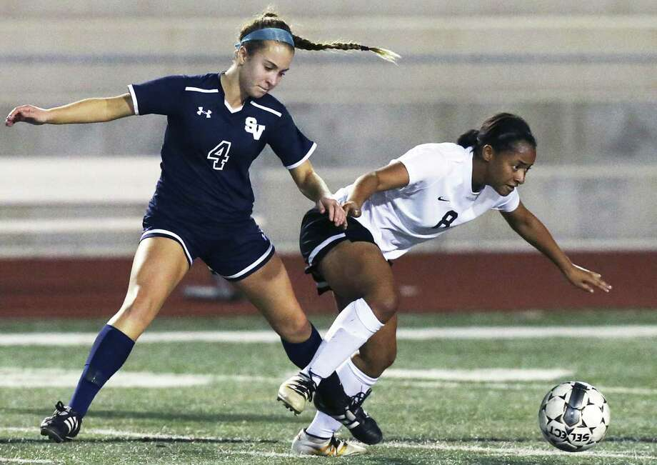 The Knight's Ariana Nelson fights through Sierra Young to get control of the ball as Steele hosts Smithson Valley in girls soccer at Steele High School stadium on January, 24, 2017. Photo: Tom Reel, Staff / San Antonio Express-News / 2017 SAN ANTONIO EXPRESS-NEWS