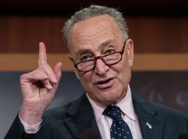Senate Minority Leader Charles Schumer, D-N.Y., accompanied by other Senate Democrats, speaks during a news conference on Capitol Hill in Washington, Tuesday, Jan. 24, 2017, to offer a proposal to spend $1 trillion on transportation and other infrastructure projects over 10 years in an attempt to engage President Donald Trump on an issue where they hope to find common ground. (AP Photo/J. Scott Applewhite) ORG XMIT: DCSA114