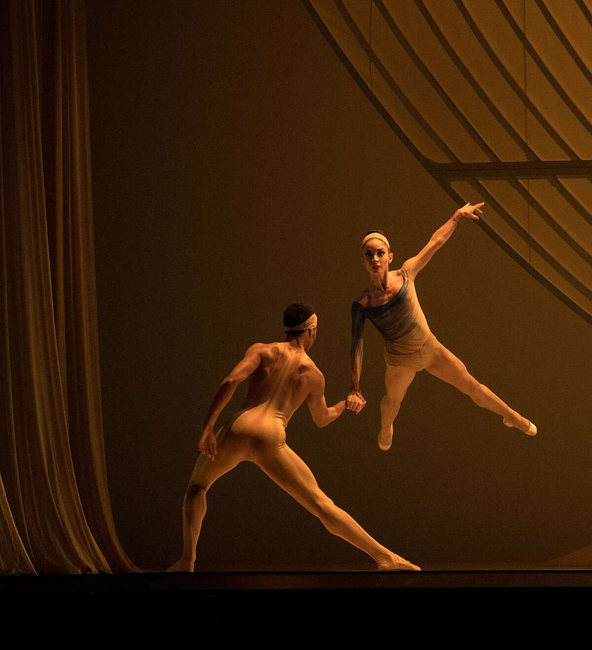Francisco Mungamba (L) lifts Doris Andre (R) during a dress rehearsal of the San Francisco Ballet's Fragile Vessels on January 24, 2017 in San Francisco.