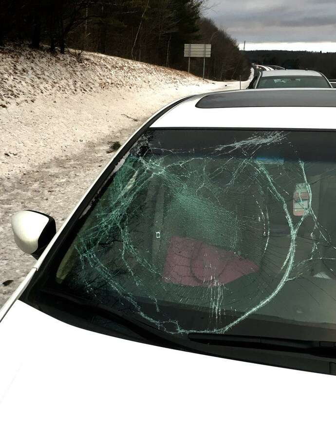 Ice from a passing vehicle smashed the windshield on a car along Interstate 84 recently Photo: / Contributed