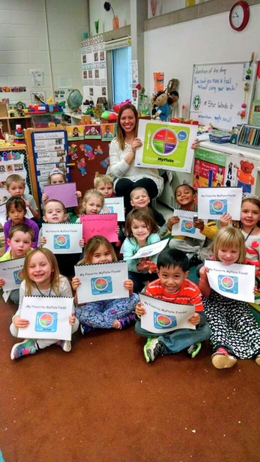 The Midland 4 Head Start/GSRP class members show off their books they made while participating in the Show Me Nutrition program with Samantha Herbert.