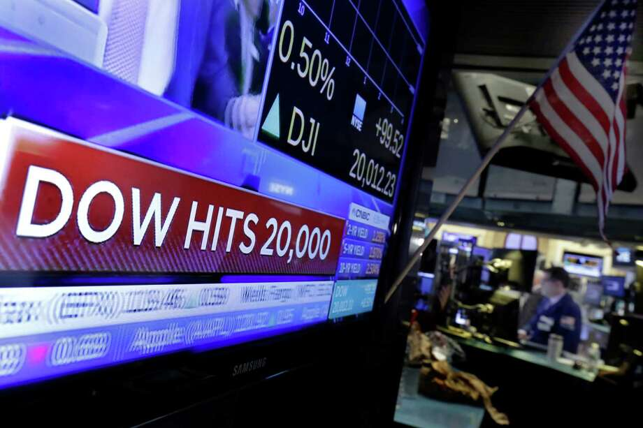 The Dow Jones industrial average is trading over 20,000 points for the first time, the latest milestone in a record-setting drive for the stock market.  (AP Photo/Richard Drew) Photo: Richard Drew, Associated Press / AP