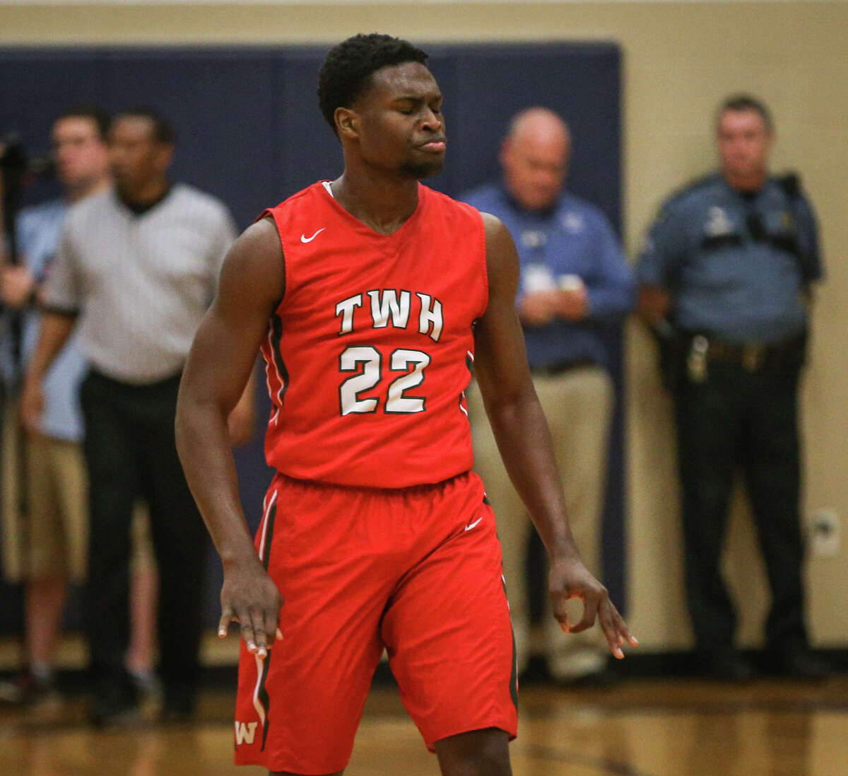The Woodlands' Romello Wilbert (22) reacts after scoring a basket at the halftime buzzer during the varsity boys basketball game on Tuesday, Jan. 24, 2017, at College Park High School. (Michael Minasi / Chronicle)