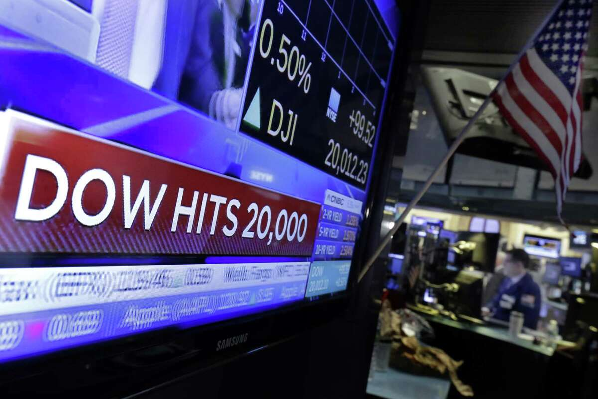 A television screen on the floor of the New York Stock Exchange headlines the Dow Jones industrial average, Wednesday, Jan. 25, 2017. The DJIA is trading over 20,000 points for the first time, the latest milestone in a record-setting drive for the stock market. The market has been marching steadily higher since bottoming out in March 2009 in the aftermath of the financial crisis. (AP Photo/Richard Drew)